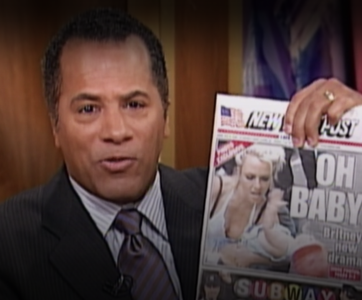 Lester Holt holding a picture of a New York Post cover with Britney holding her baby