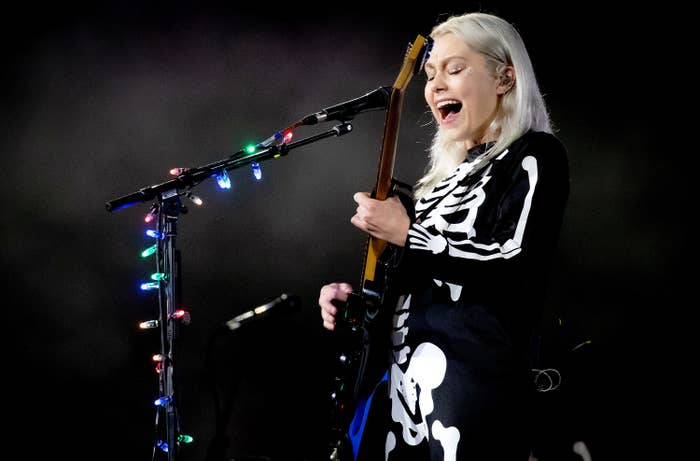 Phoebe Bridgers playing guitar and singing in a skeleton costume at Red Rocks