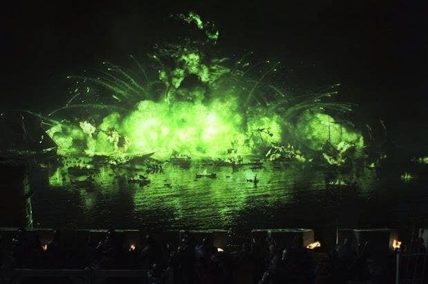 exploding green fire over water