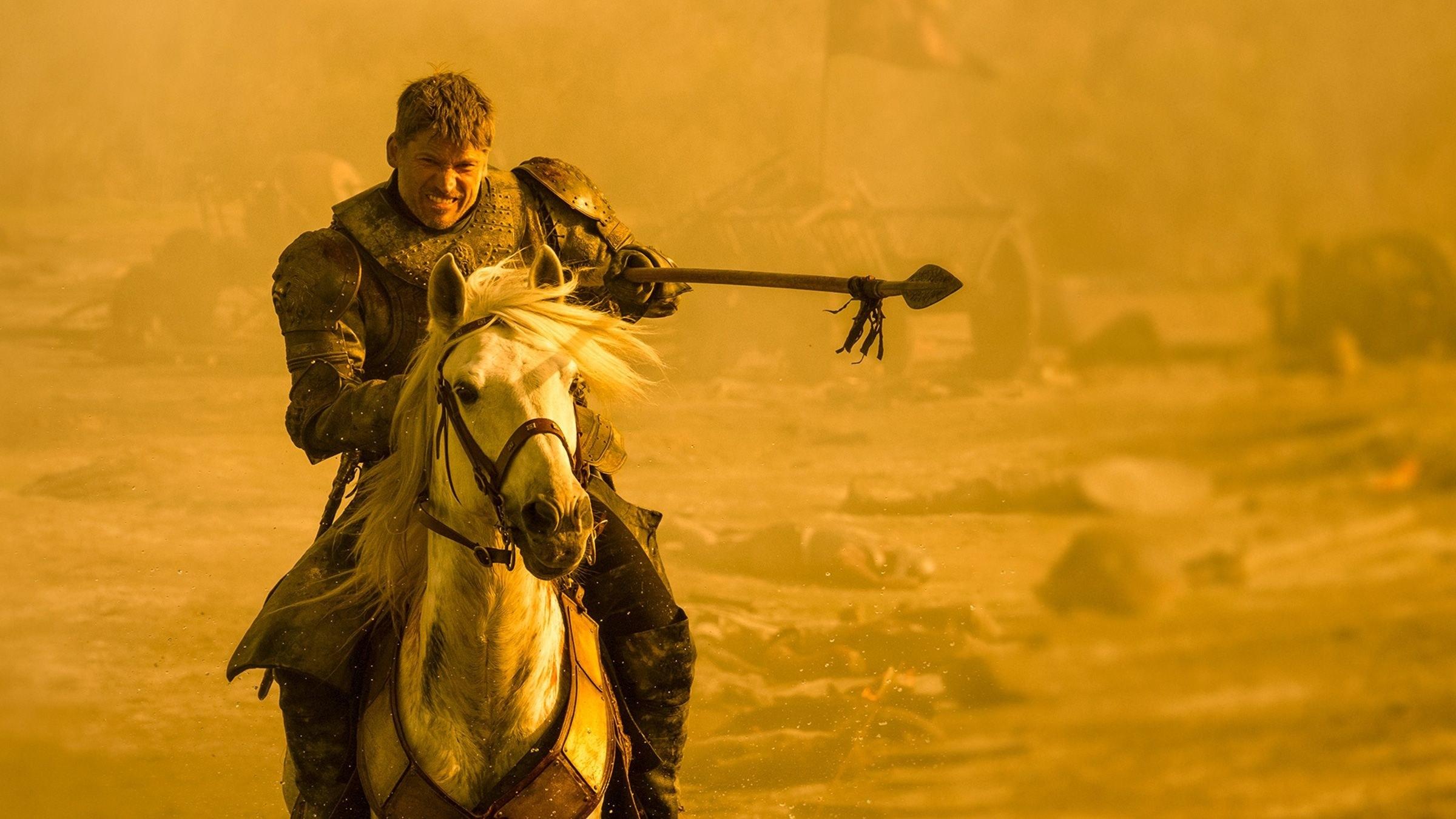 jaime lannister rides a horse in the desert