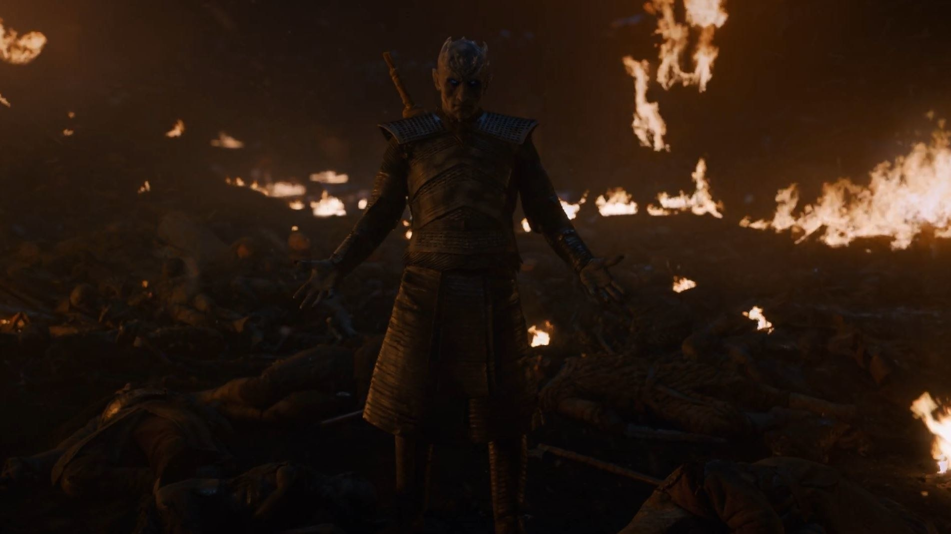white walker king standing in front of fire