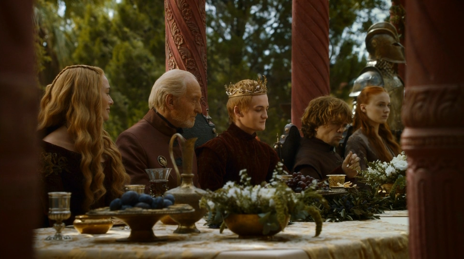 lannisters sit at a long dining table