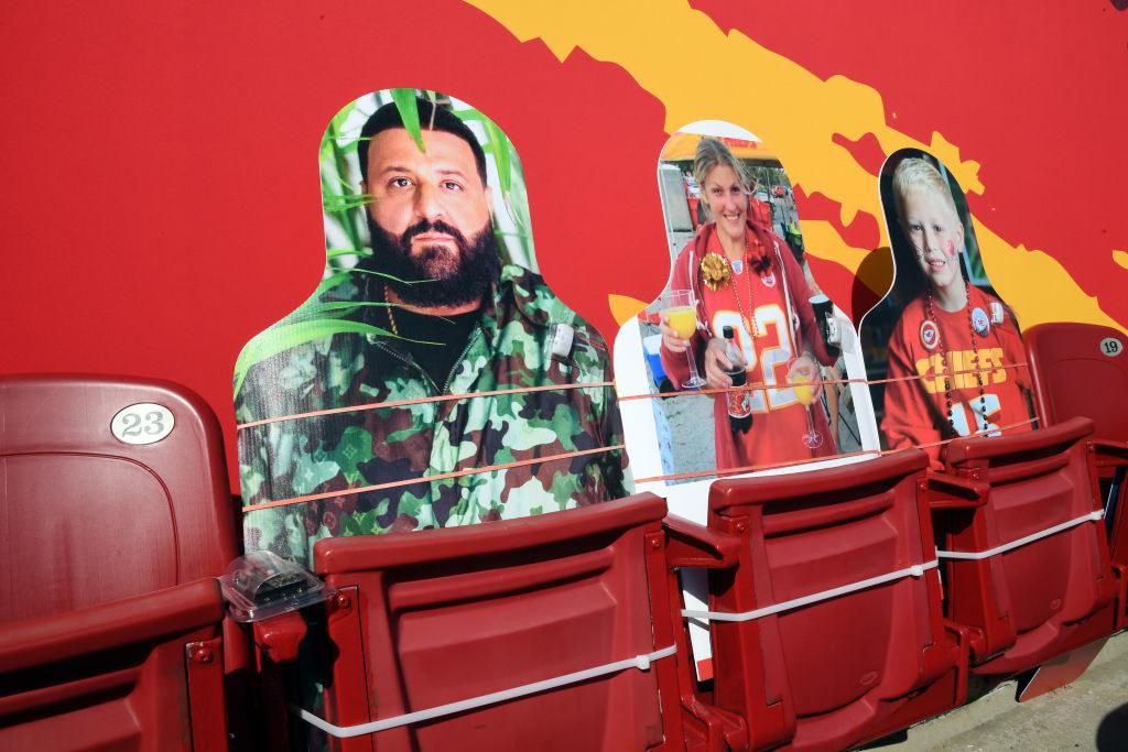 A cutout of DJ Khaled next to cutouts of a woman and a child