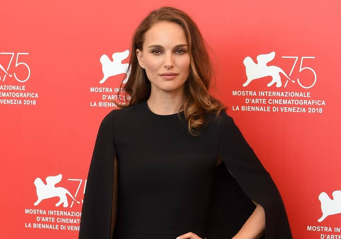Natalie poses on a red carpet