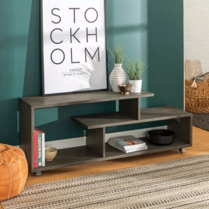 The asymmetrical TV stand in the color gray wash