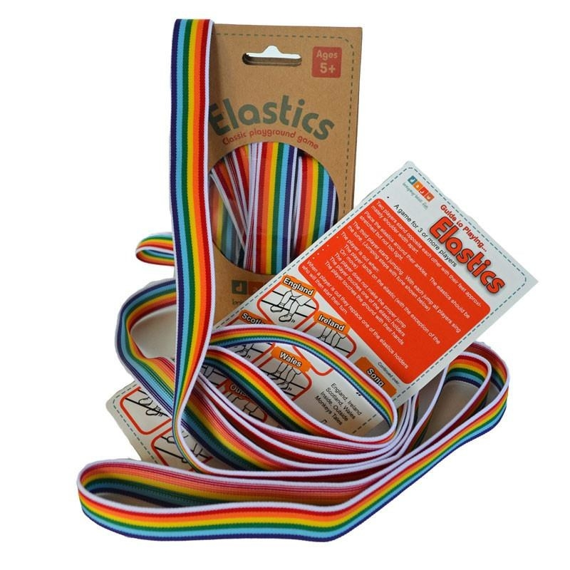 An elastic rainbow game string set coming out of its packaging