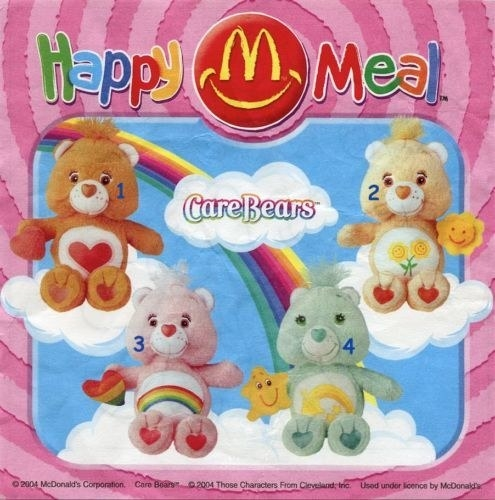 A vintage Happy Meal box featuring a photo of four collectable Care Bears