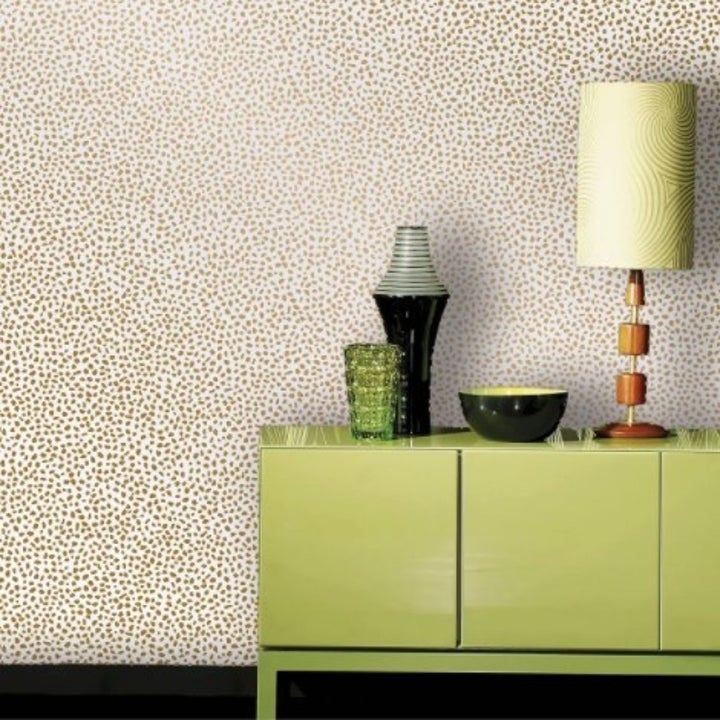 The speckled dot wallpaper in gold