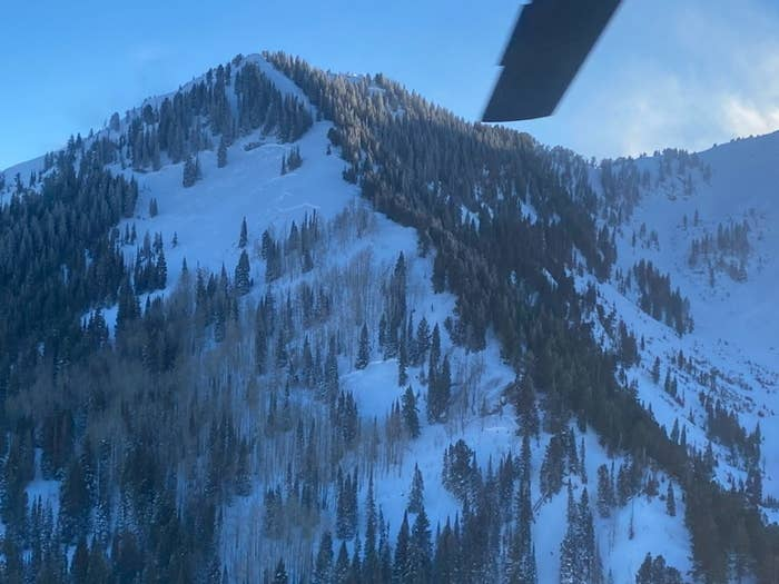 A snow covered mountain seen from a helicopter