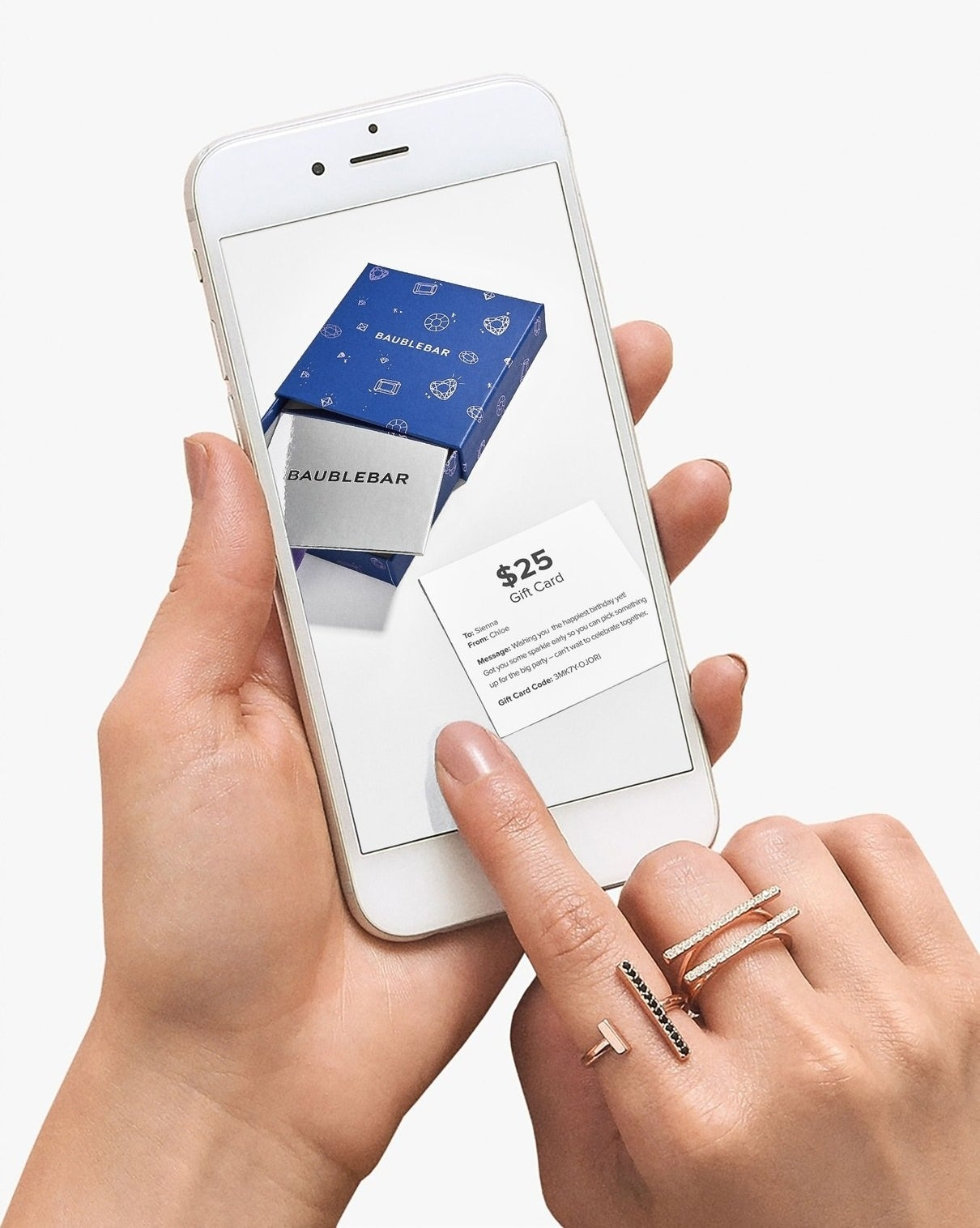 A hand using their smartphone to open a BaubleBar e-gift card