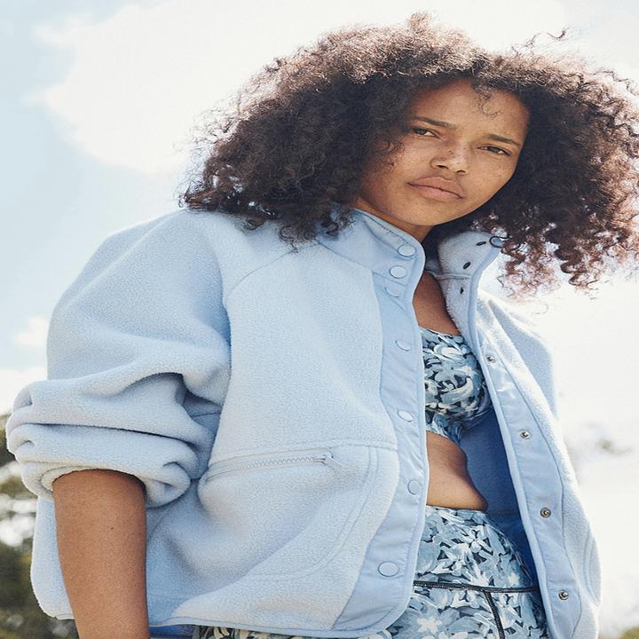 model wearing the blue sherpa jacket