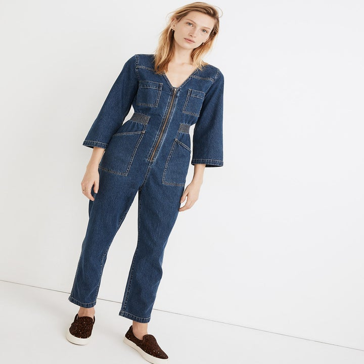 model wearing the blue denim jumpsuit