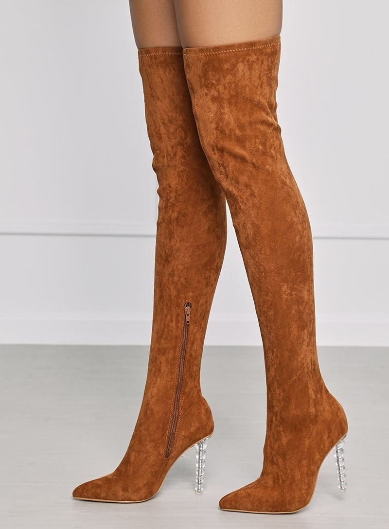 The tan suede boots with clear ball drop pedestal heel
