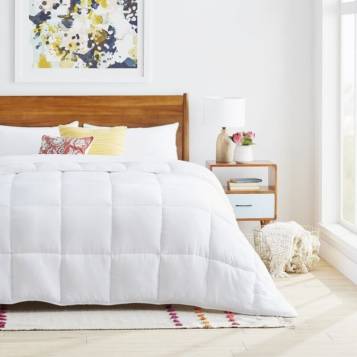 white quilted comforter on a bed
