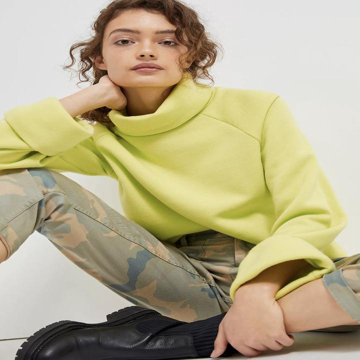 model wearing bright yellow sweater