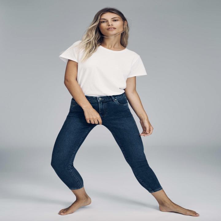 model wearing the dark blue jeans