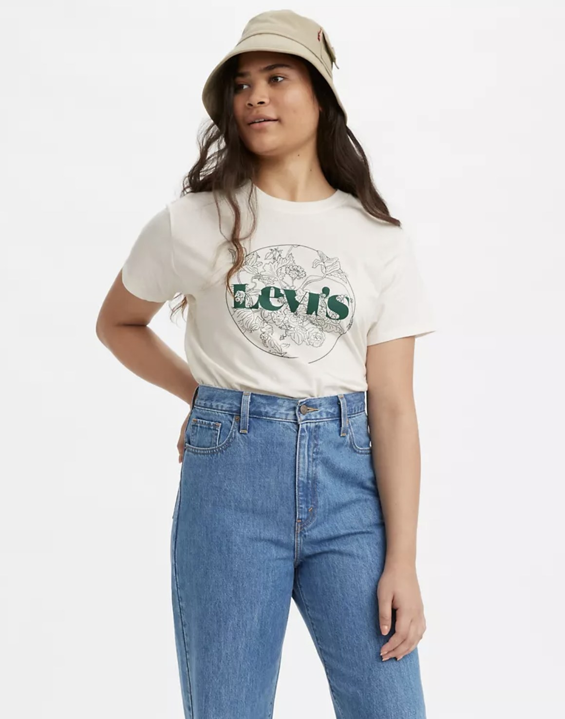 Model is wearing high waisted denim jeans and a white graphic tee