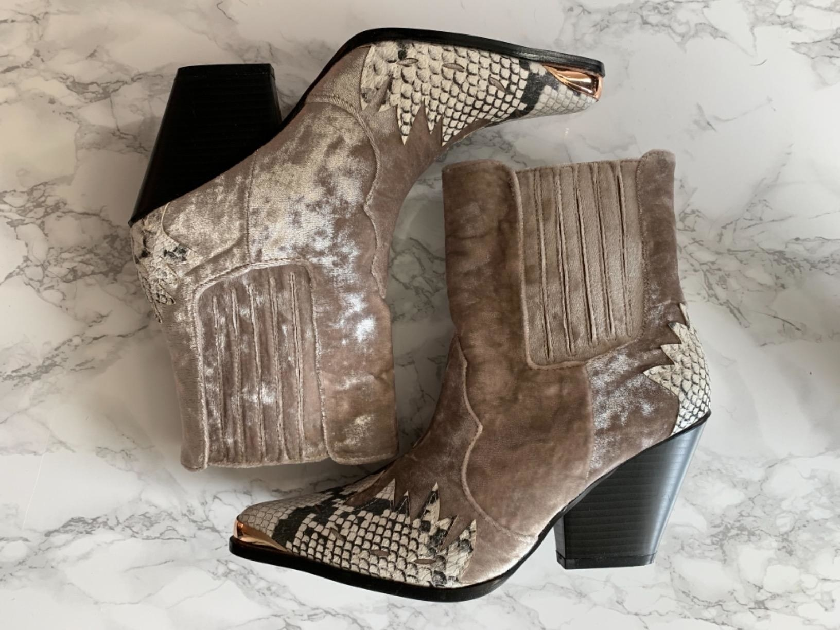 The mixed media boots with taupe-colored velvet and snakeskin accents and black heel