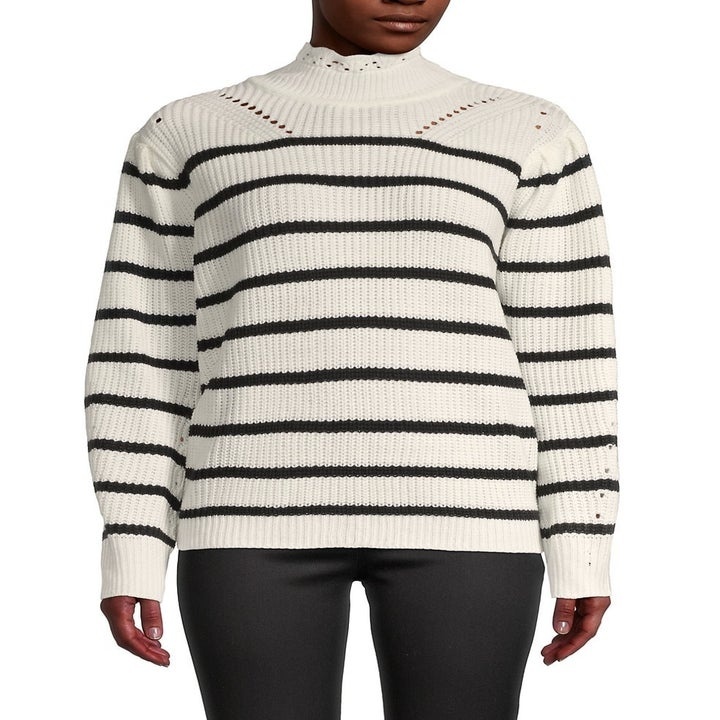 model wearing a black and white striped sweater