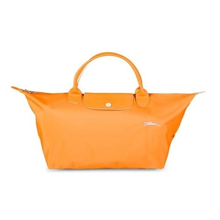 the orange Longchamp tote