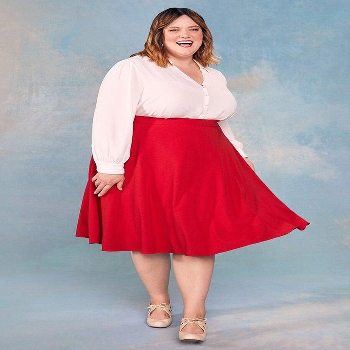 model wearing the red midi skirt