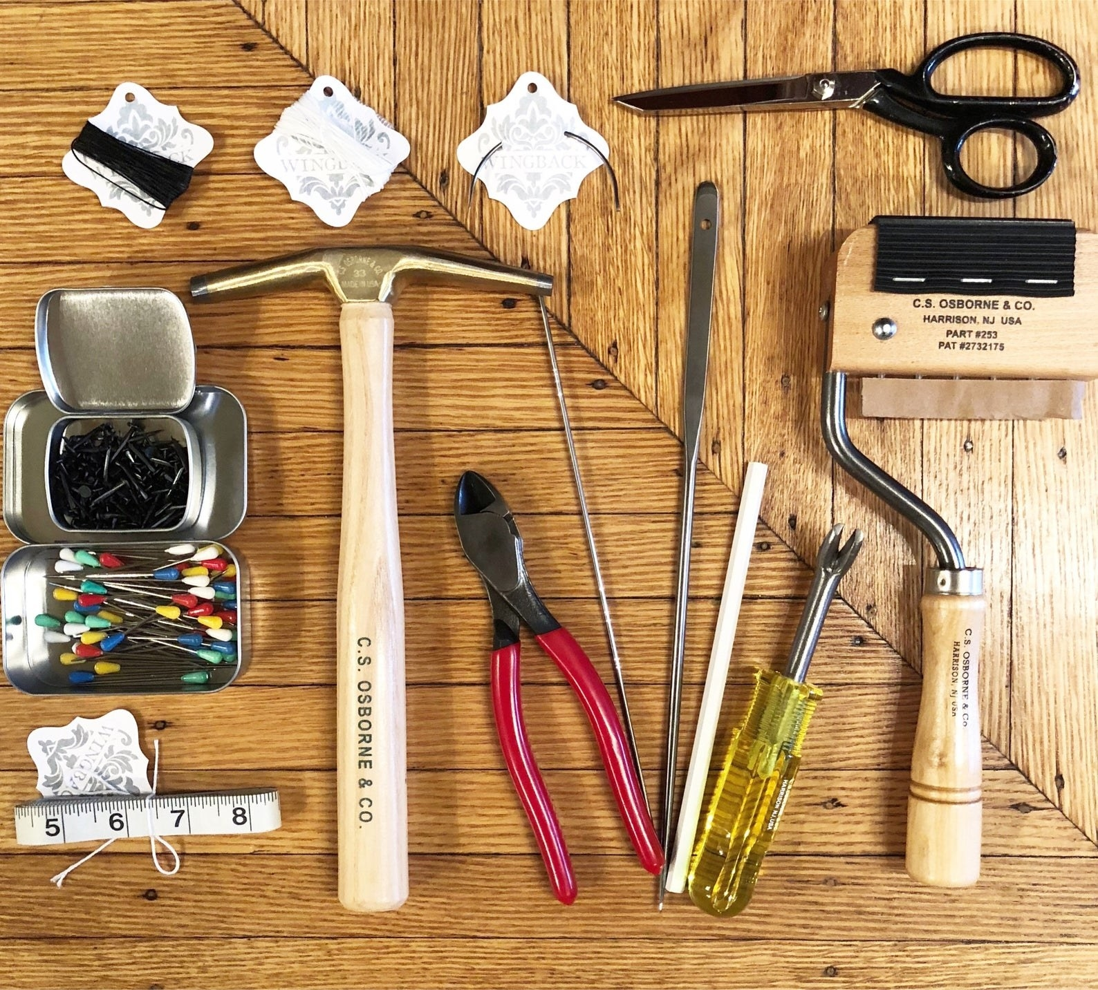 the complete furniture repair upholstery kit laid out on a wooden table