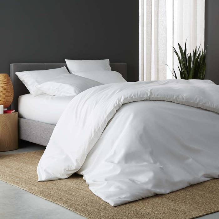 white duvet cover, sheets, and pillowcases on a bed