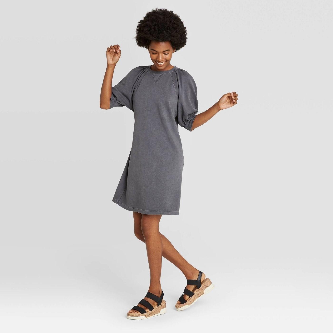Model wearing dark grey dress