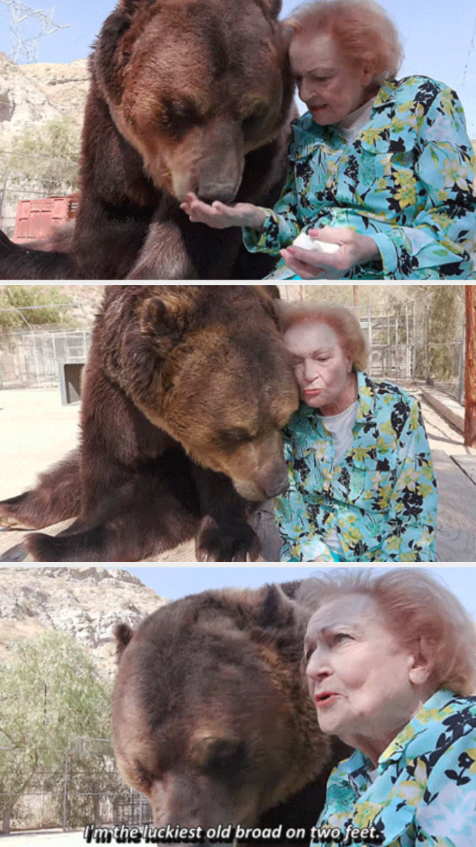 Betty White spending time with a bear at a zoo