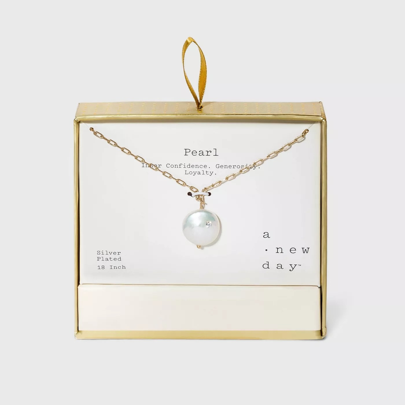 A gold chain necklace with a single pearl