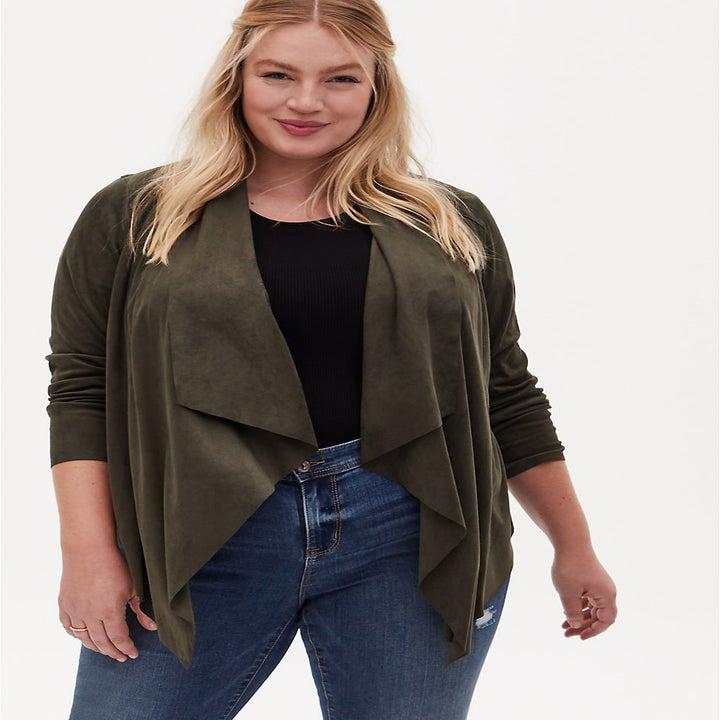 model wearing olive green sweater