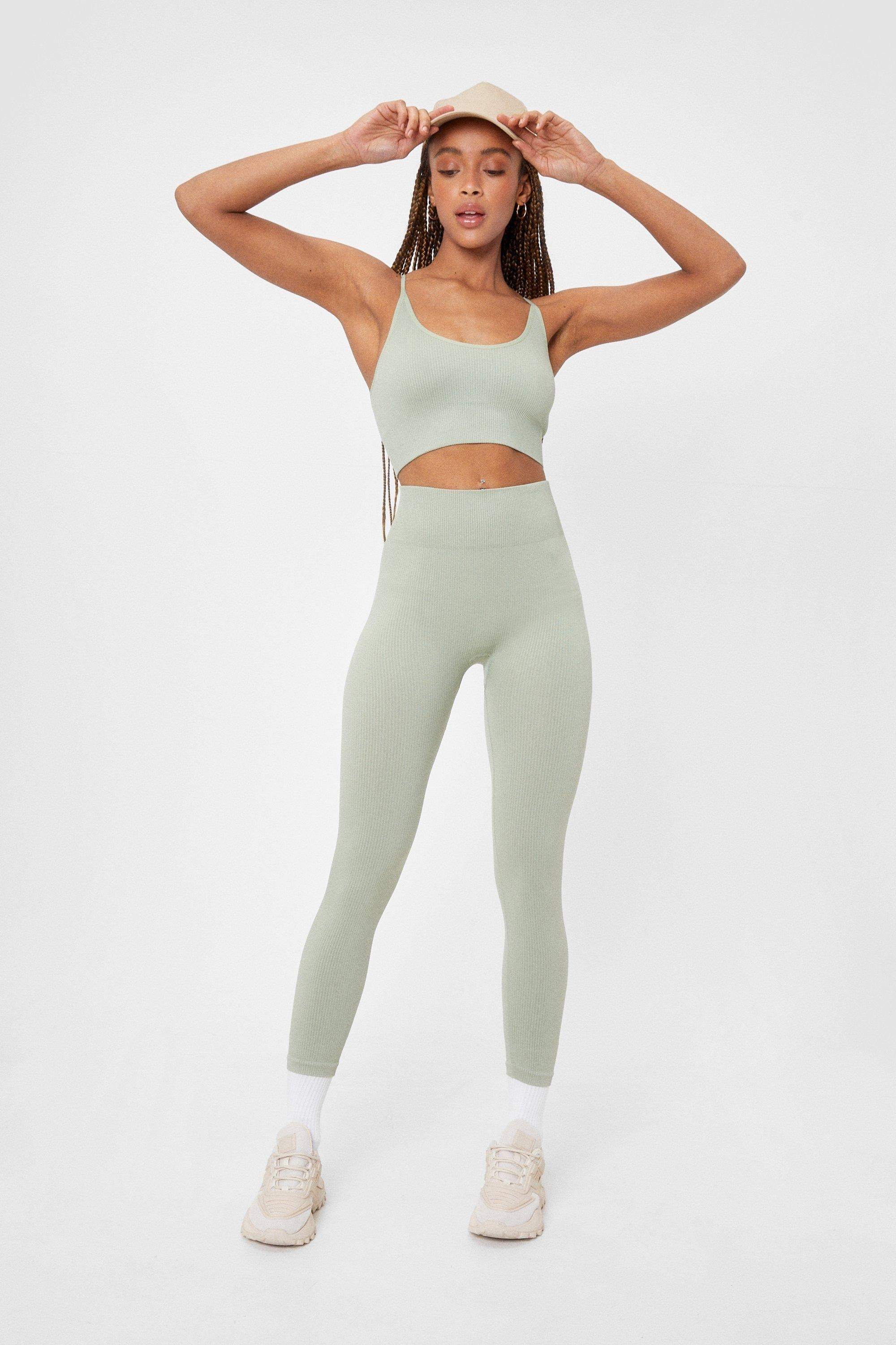 model wearing the light green leggings and sports bra