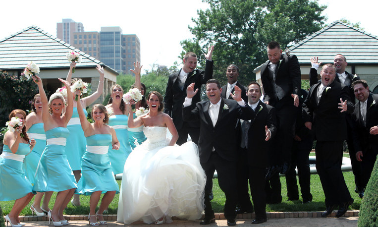 A large wedding party with tons of bridesmaids and groomsmen
