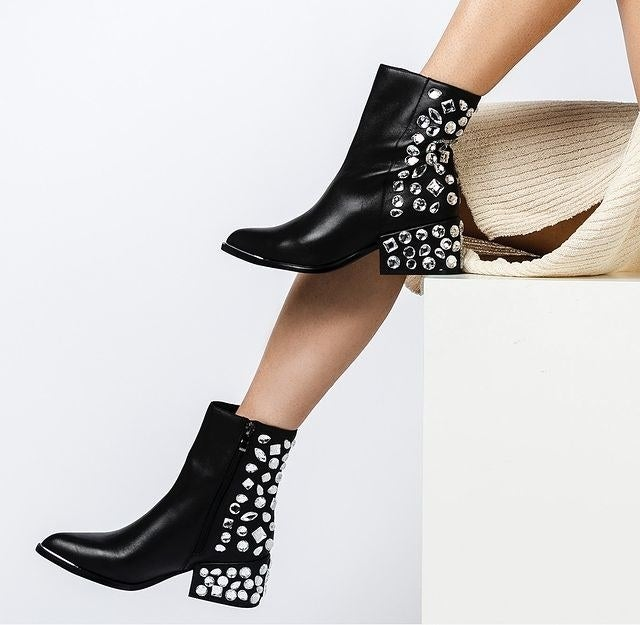 The black boots with mirrored gems on the heel and back of the shoe