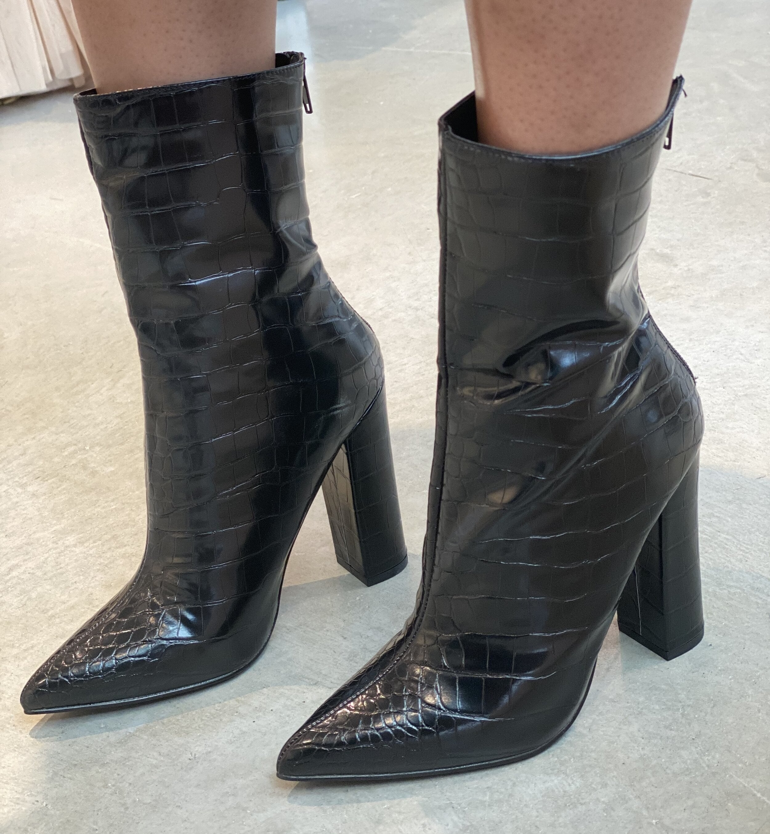The black pointed croc-style booties