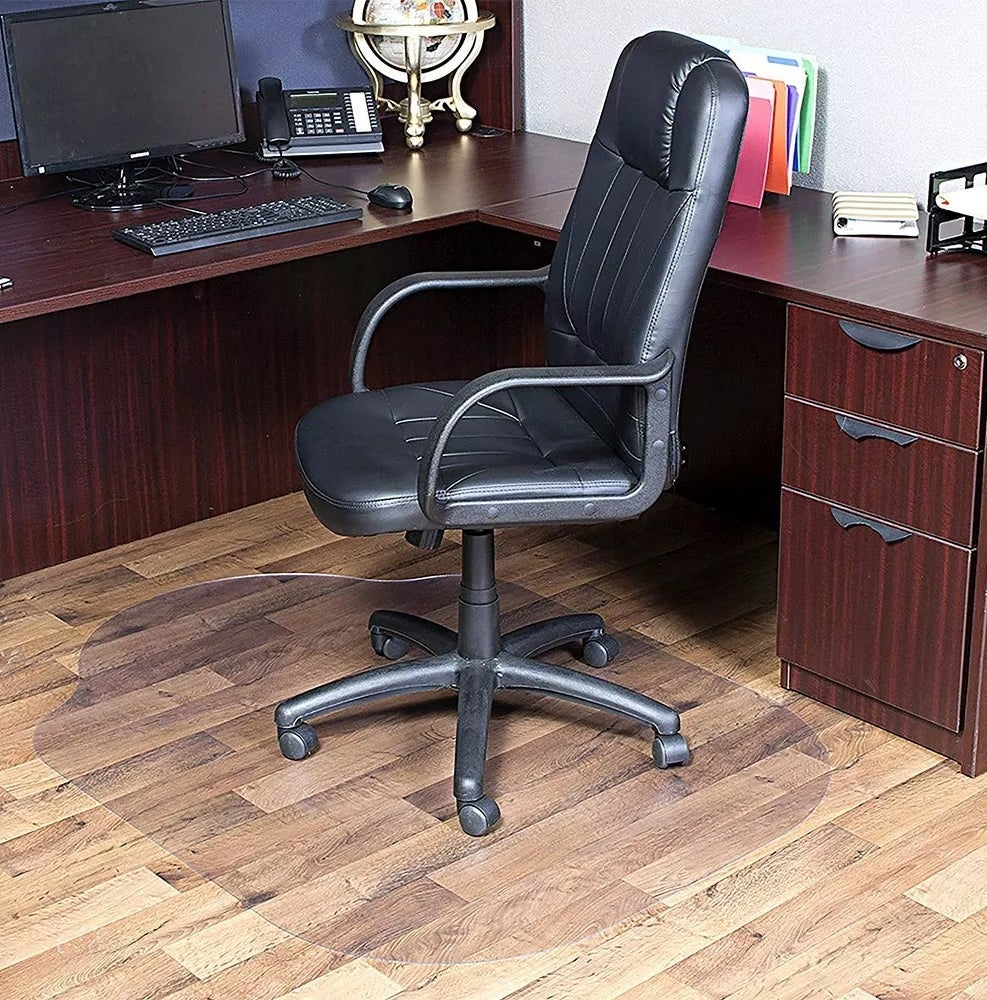 A desk chair on a clear mat
