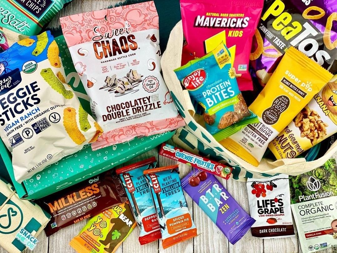 assortment of snacks like clif bars, protein bars, and veggie sticks