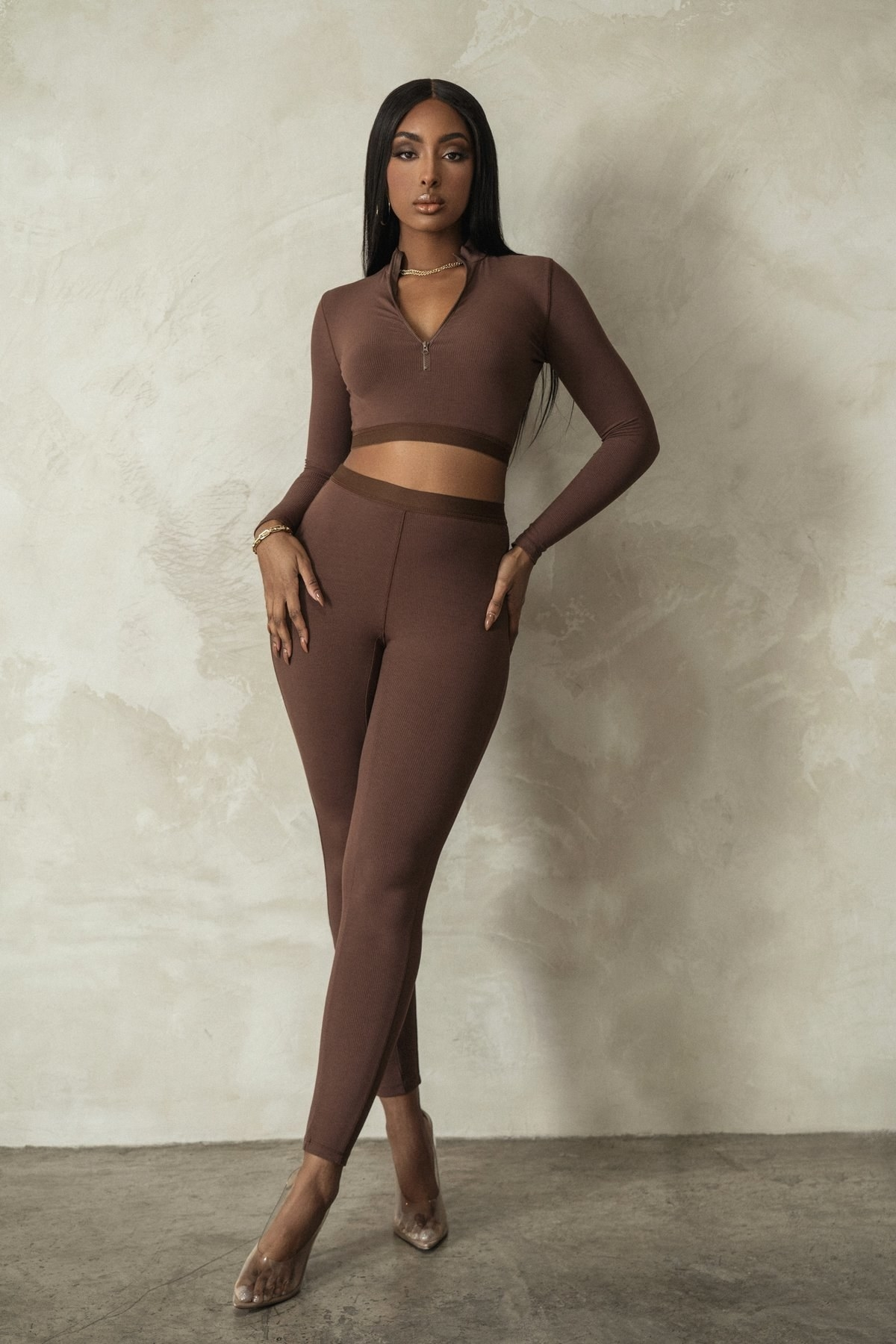 model wearing the brown cropped top and high waisted leggings