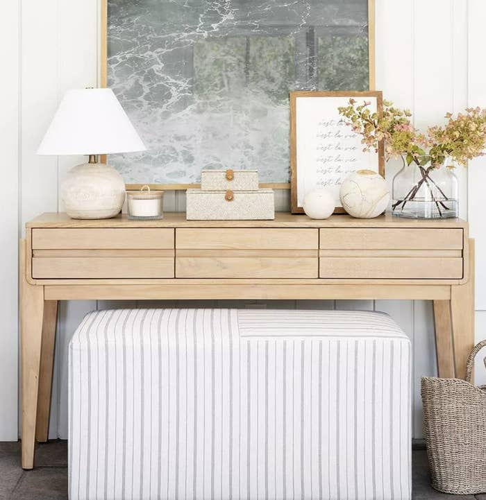 A woven box on a console table