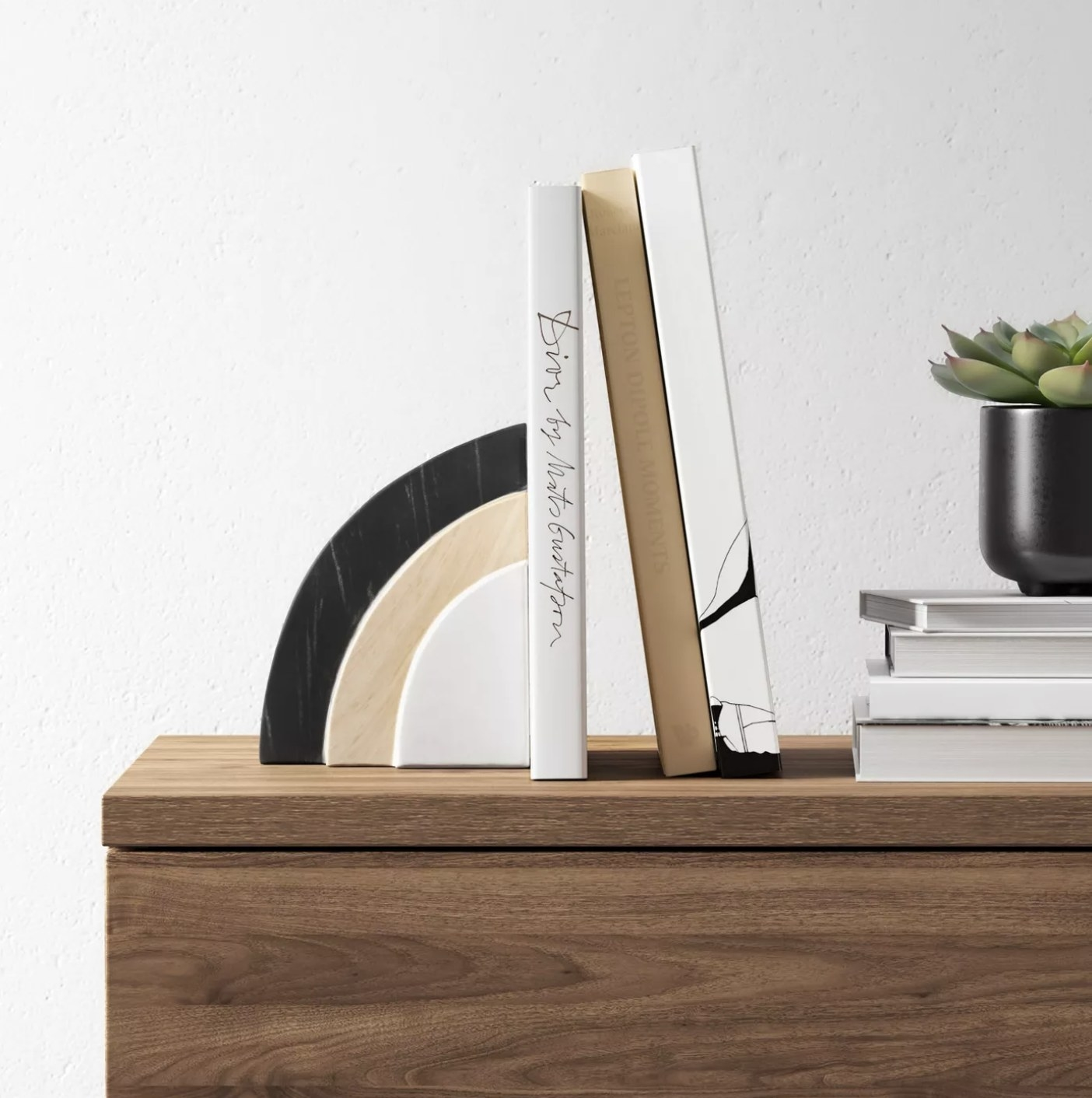 The marble bookend on a table holding up books