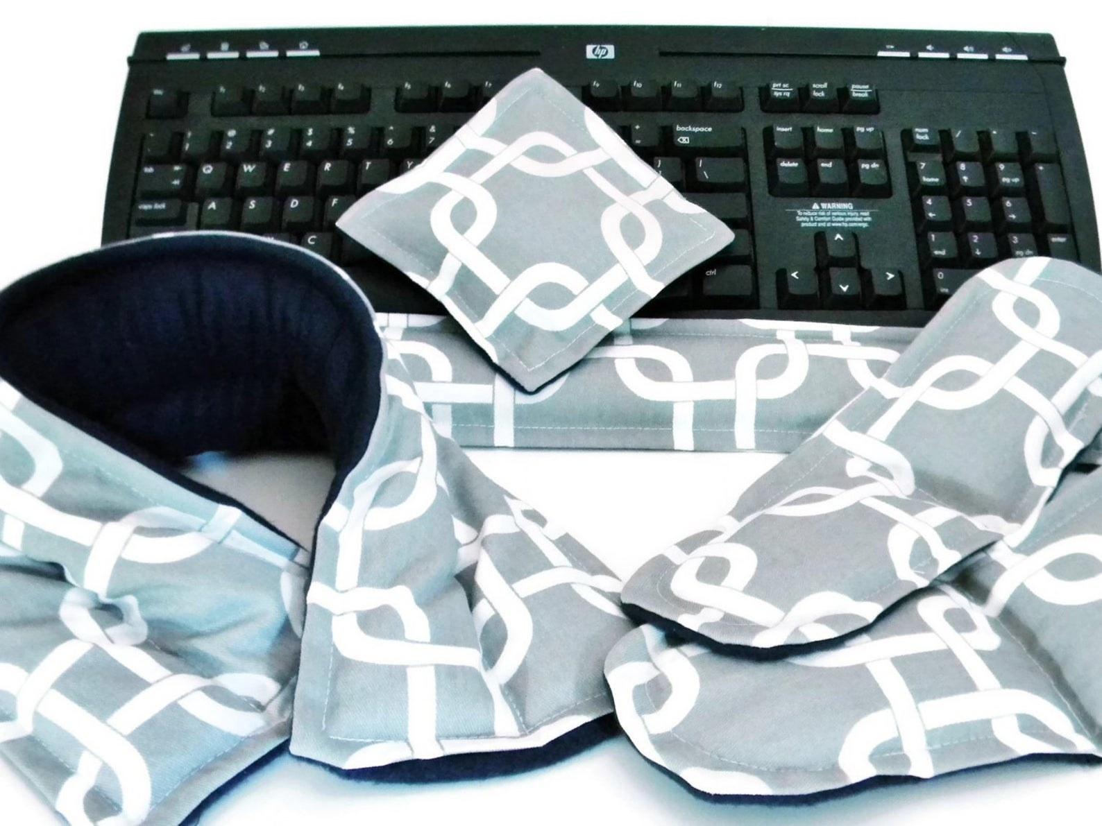 The heat pads in gray with white chain designs