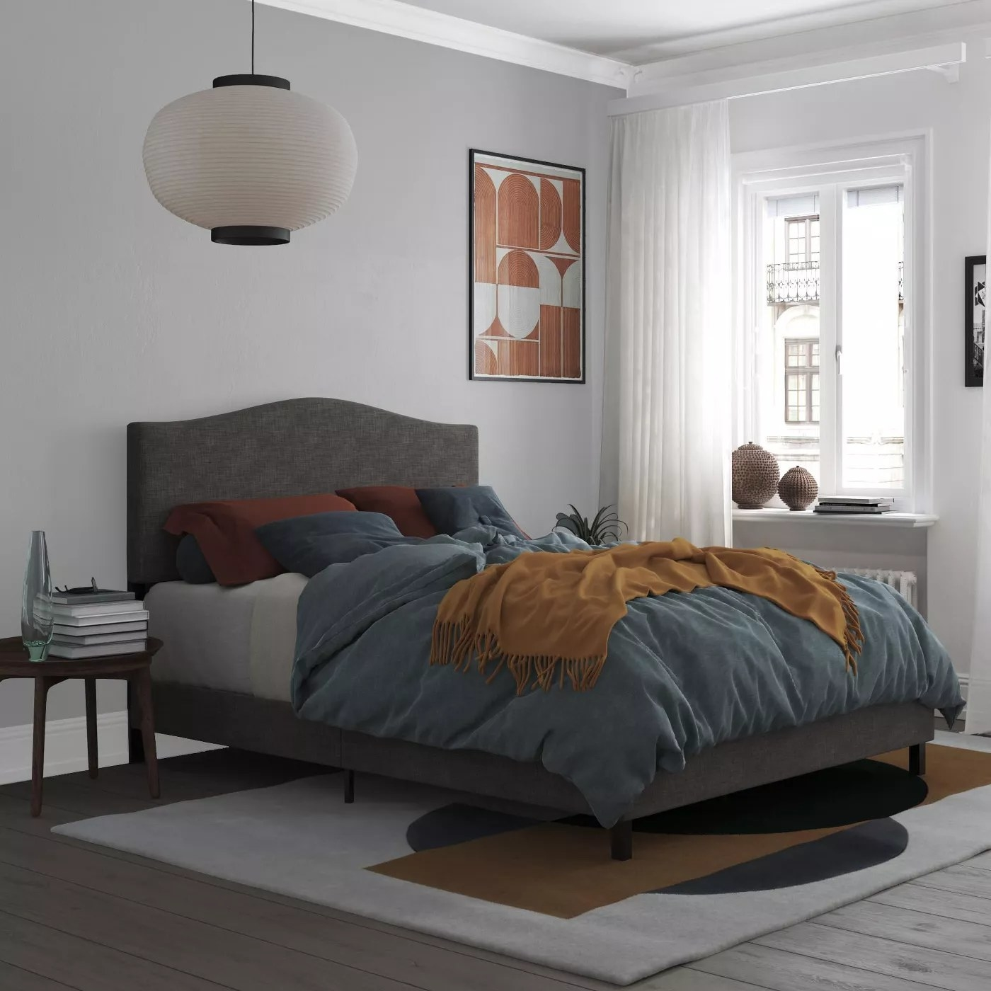 The gray, upholstered bed frame