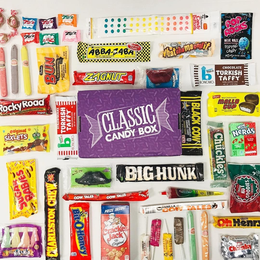 Various assorted candies in front of the Classic Candy Box like Mallo Cup, Charleston Chew, Nerds, and Pop Rocks