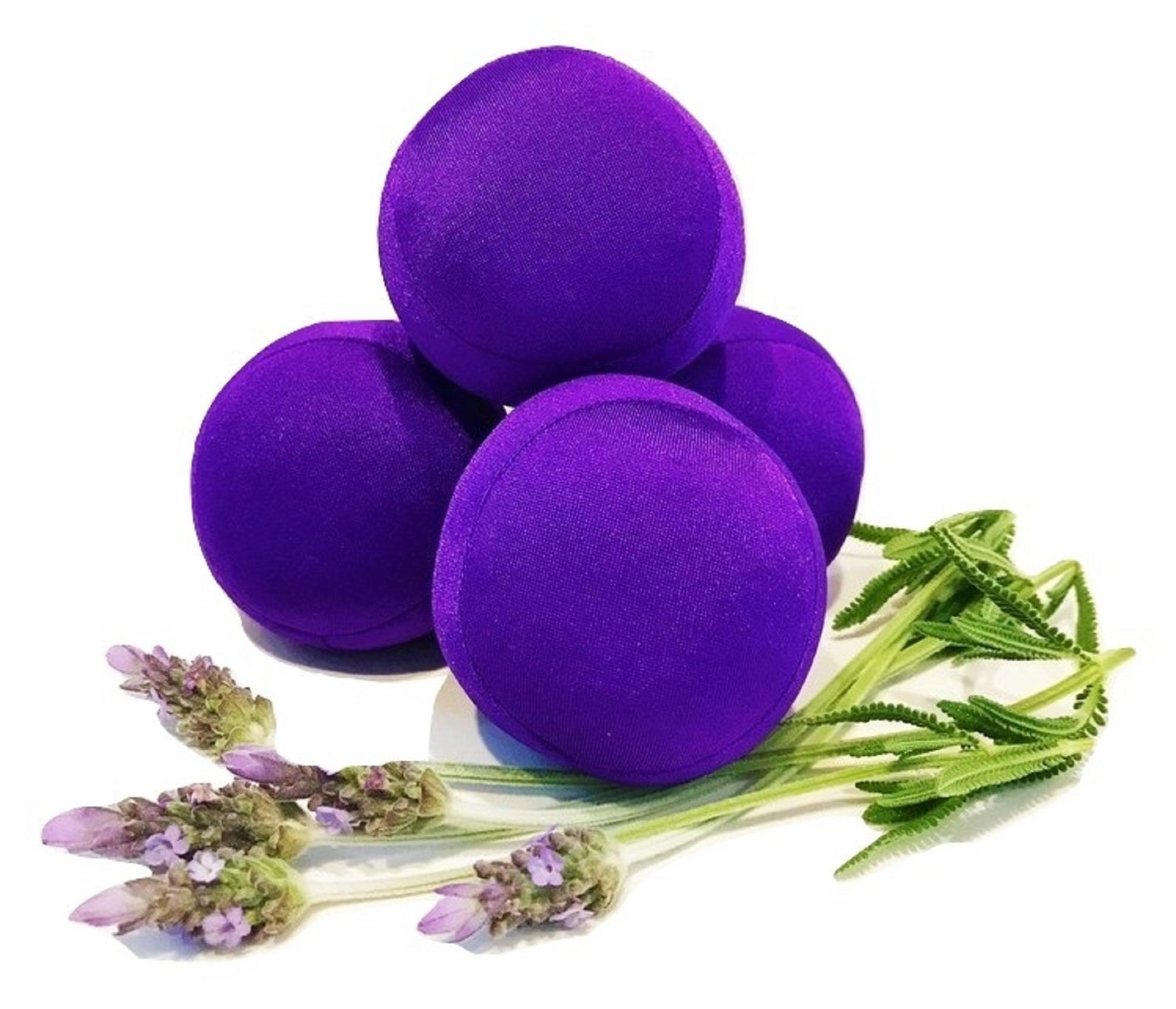 Four small round purple balls next to lavender
