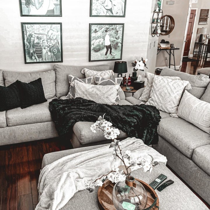 White and black blankets on top of a L-shaped couch