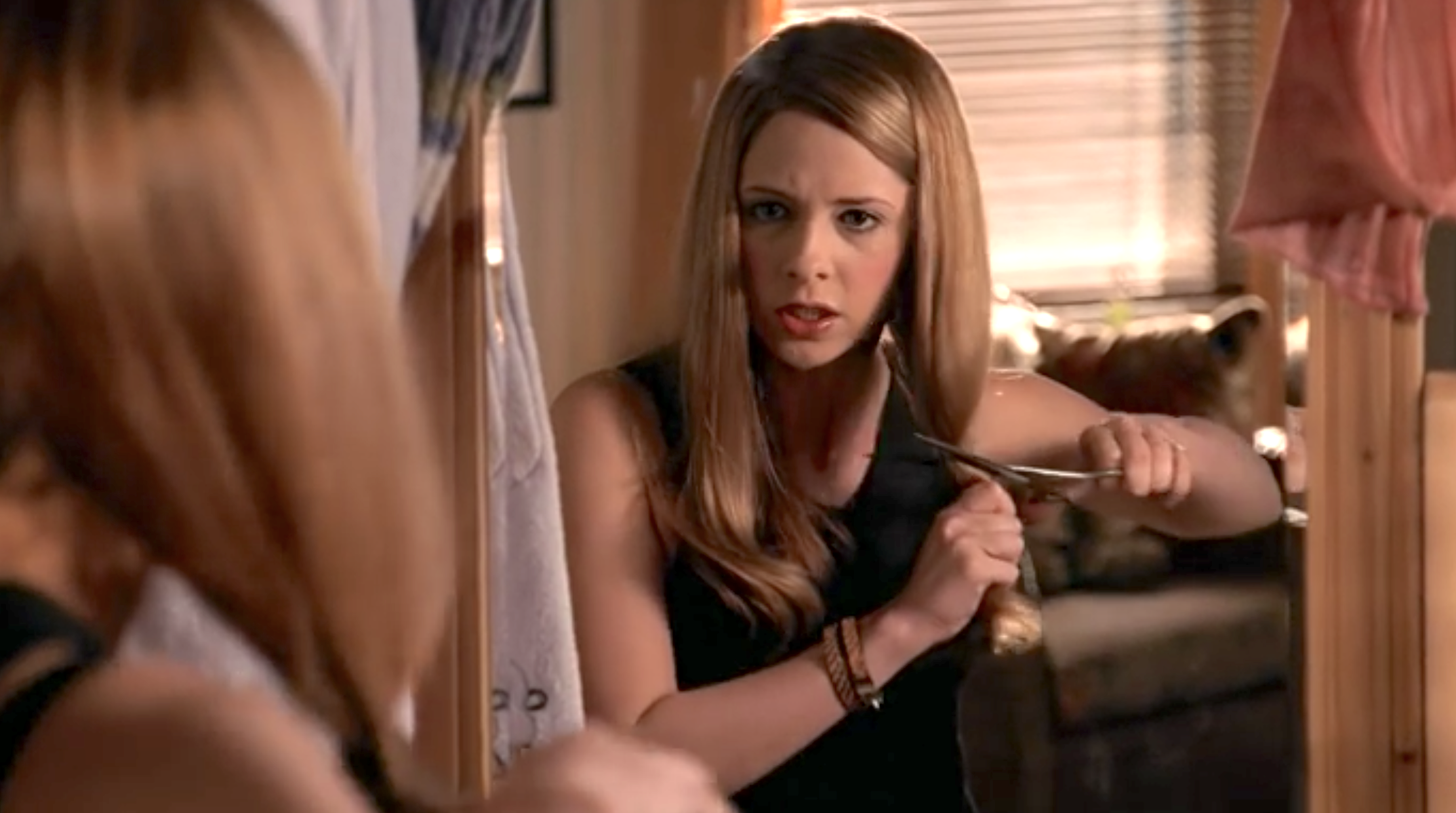 Buffy cuts off her hair in Buffy the Vampire Slayer