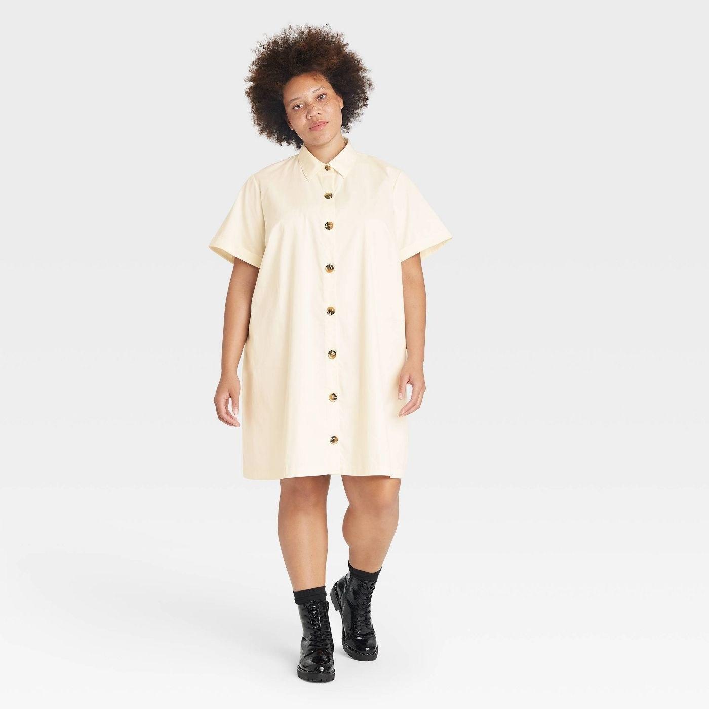 Model wearing off-white button down shirt dress