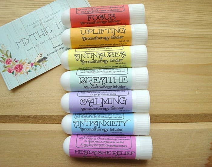seven aromatherapy inhalers laid out in rainbow colors