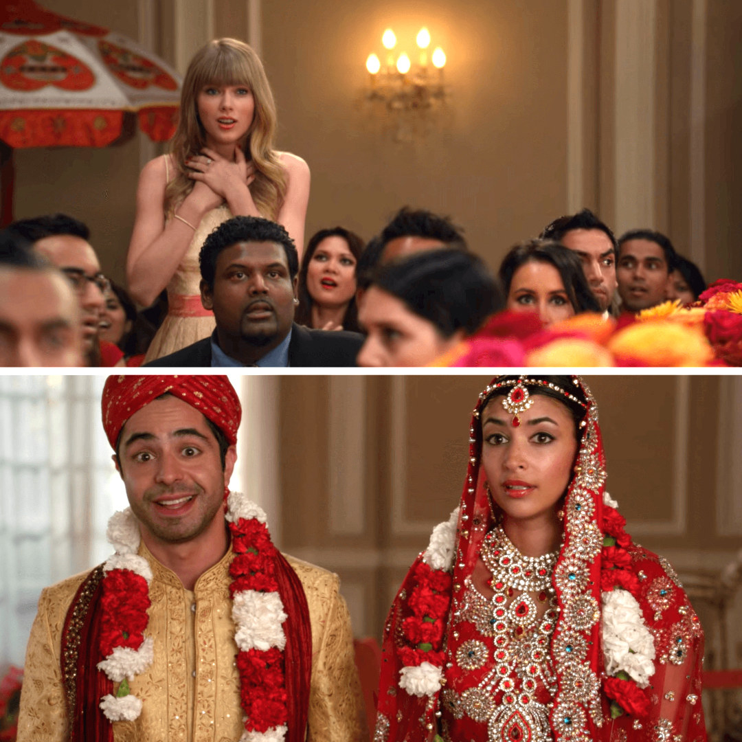 Taylor Swift standing up with her hands on her heart during Cece and Shivrang's wedding on New Girl