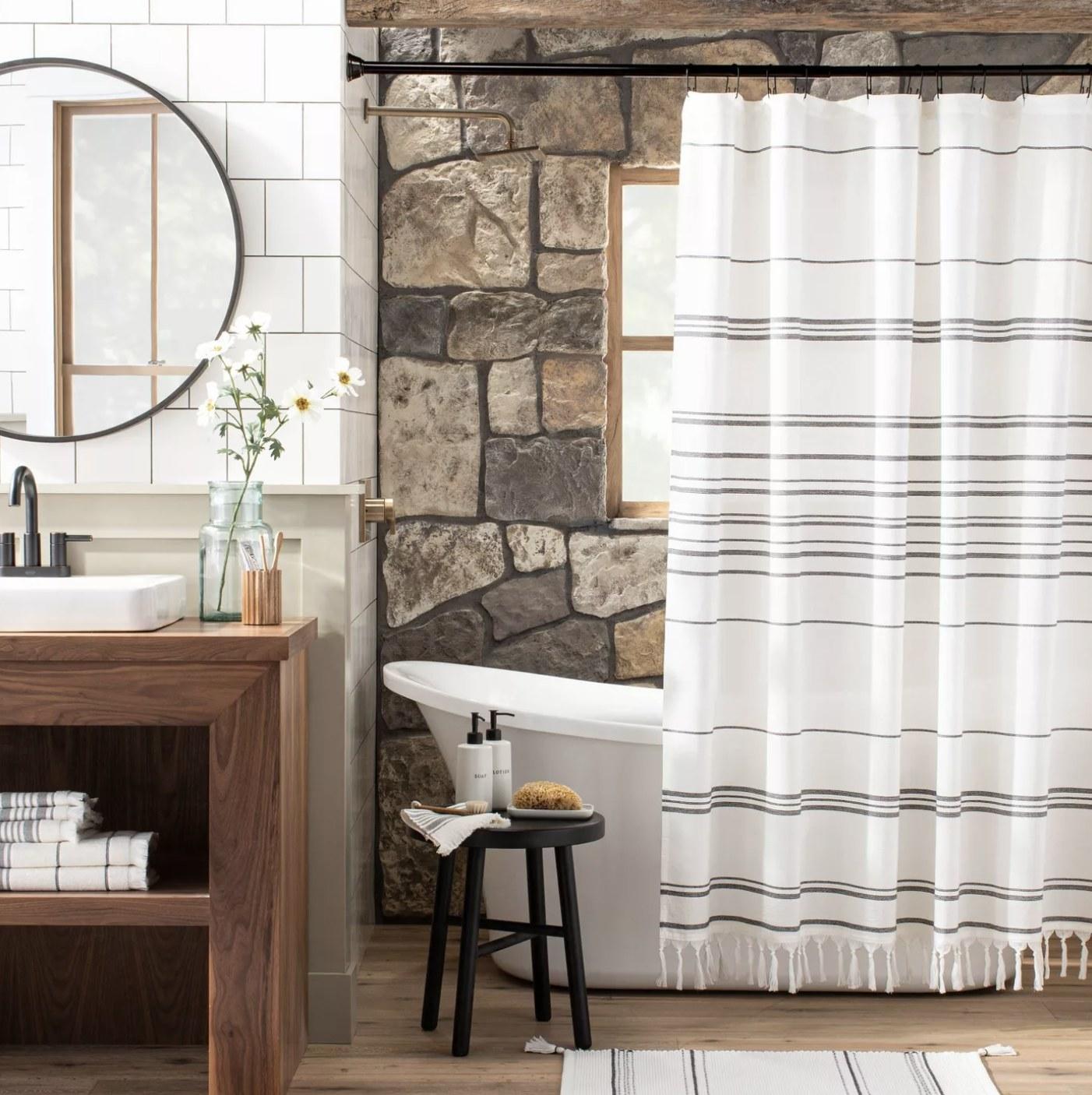 White striped shower curtain in a bathroom